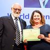 Catherine Draper receives WBF Grand Master certificate from WBF President Gianarrigo Rona