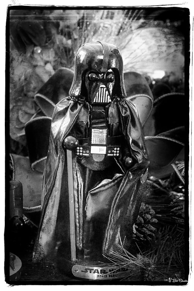 "Even Darth Vader appeared as a Nutcracker figurine in the 2017 version of ""The 12 Days of Christmas"" at the Dallas Arboretum and Botanical Garden, Dallas, Texas. Black and white film-look rendering of raw image. Raw development in DxO PhotoLab 2. Post processing in ON1 Photo RAW 2019 (JohnnyStyle SFO: Haight - Ashbury with Black and White then applied). Olympus PEN-F, OLYMPUS M.12-100mm F4.0, 50mm, f4.5, 1/50 sec, 25600 iso. Photo: Bob Shrader."
