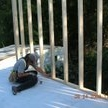 """Volunteer working on """"The house that Bruce built"""" - a house sponsored in memory of a long-term volunteer, Bruce Marsden. ab"""