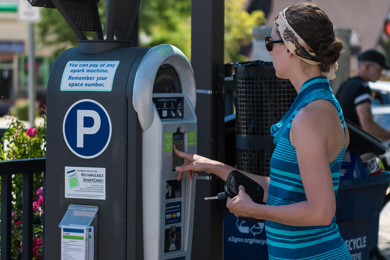 Jamie, paying for parking in dowtown Ann Arbor.  June, 2016.