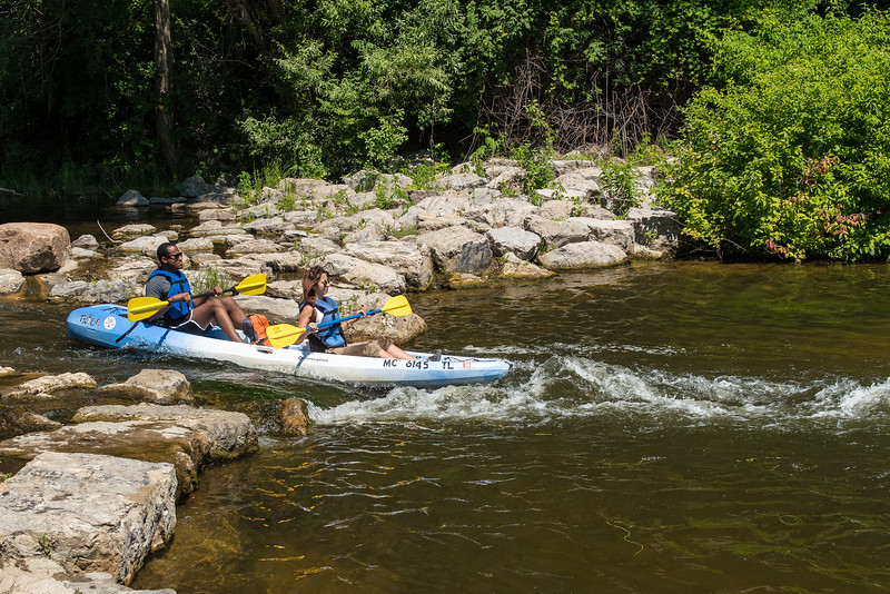 There are a series of about seven of these constructed rapids.  It's a short enough distance that you can haul your kayak a couple hundered yards upsteam and do it again.   Very fun.