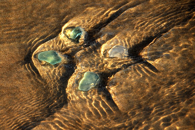 Smoothed glass chunks on the beach of Lake Michigan