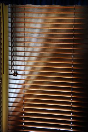 The Morning Sun through Window Shade Slats