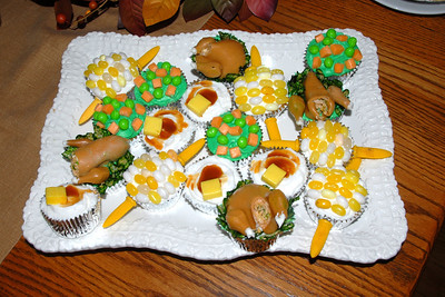 Cupcakes decorated as Thanksgiving Dinner - Peas and Carrots, Mashed Potatoes and Butter, Turkey, etc - all out of Candy!