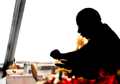 Buddhist lama teaching the mandala offerings meditation