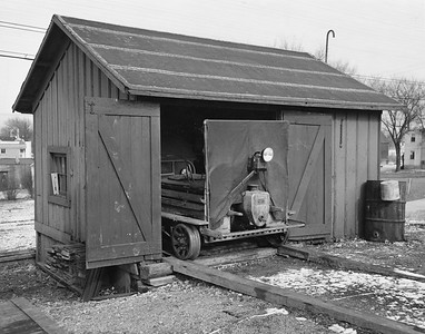 2017.17.P.002--mcrm collection 8x10 print--CB&Q--Fairmont track speeder in section shed--location unknown--1953 0126