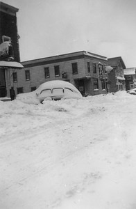 2009.033.1.17--print 3x4.5--C&NW--hotel looking north after snowstorm--Cuba City WI--1953 0100
