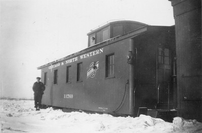 2009.033.1.11--print 2x3--C&NW--freight train 629 wooden caboose on wye with CW Whitman conductor--Montfort Jct WI--1953 0100