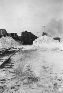 2009.033.1.01--print 2x3--C&NW--scene of stockpen and freight train 628 picking up stockcars after snowstorm--Livingston WI--1953 0200