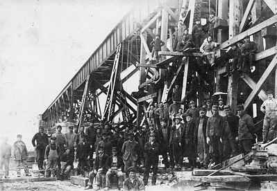2017.17.CC.001--mcrm collection 5x7 cabinet card--unknown--scene with crews and steel bridge--location unknown--no date