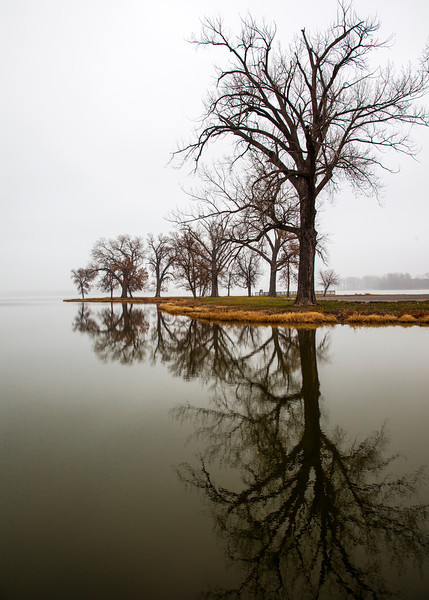 Big reflection.<br /> December 2, 2012<br /> <br /> This is a shot that I got over at Lake Manawa after the fog really started thinning out.  I saw this reflection as I drove by, and immediately had to pull the car over so I could run back to take a few shots.  And an eagle even flew over while I was standing out there.   Had the wrong lens on though, for a flying eagle shot.