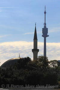 "Spires 2011-09-12  Looking slightly south of east with the sun behind Vienna's first mosque, dedicated in 1979 with a 32m high minaret.  Behind it is the ""Danube Tower"", with an observation deck and restaurant 152m above ground.  Yesterday's shot of stairs didn't meet with much approval (or with some hearty disapproval by a few).  Oh well.  Another day, another shot."