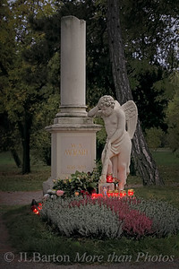 "St. Marx Cemetery, Vienna.  Mozarts (putative) grave A shot from the old cemetery, like the one I showed yesterday in the Dailies gallery.  I've kept the light muted here - as I remember it.  Sun hidden behind high fog and just about to set.  The complete series is in my Vienna gallery http://www.jerrybarton.eu/Landscapes/Vienna/7986304_r9xtwT  update: @Dianne:  Wolfgang Amadeus Mozart was poor when he died in 1791.  At the time, mass graves (and re-usable coffins with hinged bottoms) were in use in Vienna for poor people.  So nobody knows exactly where he was buried.  There are no written records.  Probably in this cemetery, but not exactly at this location.  Vienna has another ""Mozart grave"" - an honorary one in the Central Cemetery, and many Mozart memorials (including in the imperial palace grounds - the one most photographed by tourists)."
