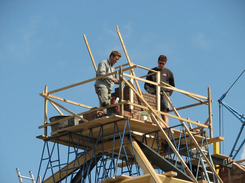 Paul and Twan bricklaying  the chimney