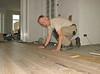 Robert and Marijn laying the oak parquet in the living room