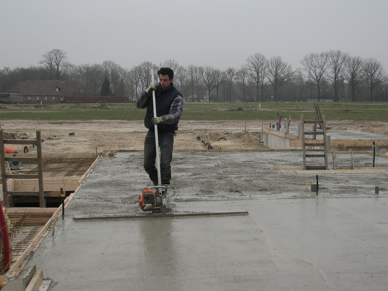 Robert is finishing the concrete floor