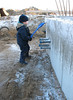 Stijn remove the snow of the cellarwall