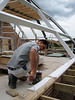 Painting the roof beams of nr 36 by Robert and Marijn