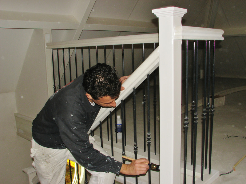 Robert is painting the bannisters (firm Robert v.d. Wetering schilder- en glaswerken)