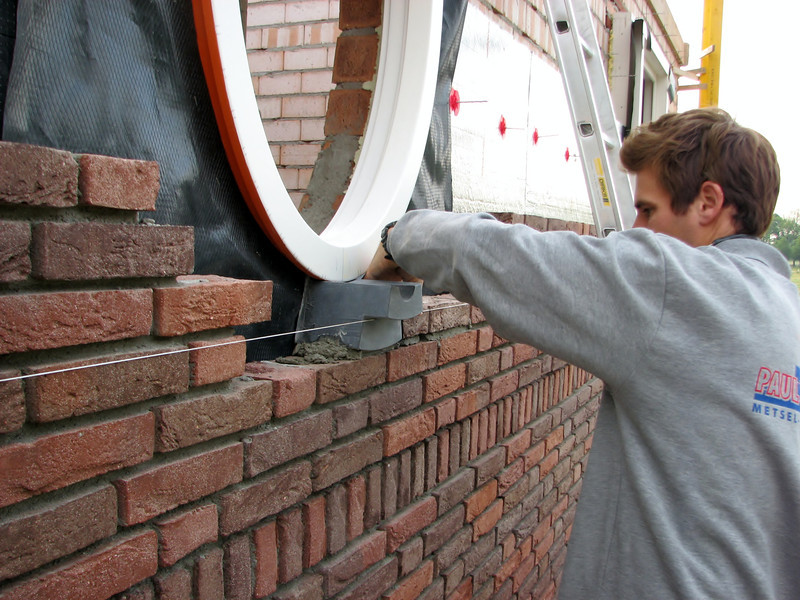 Paul mounting the water outlet of the oval window