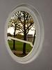 Plastered oval window frame