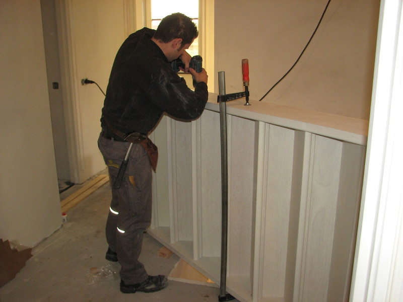 Ton van den Elzen (firm v.d. Linden) mounting the stair parts on the first floor