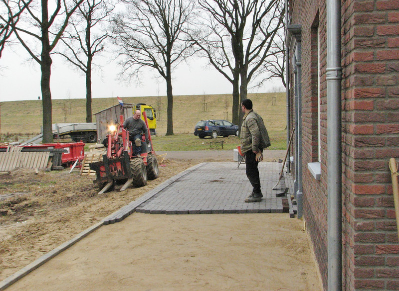 Firm Driessen paving the surface around the house