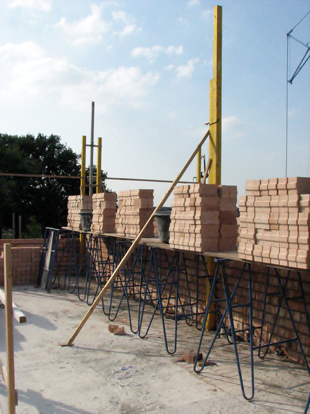 Bricklaying walls of the attic and highest point of the roof