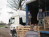 Stijn keep one's balance. (Unloading pallets to store bricks)