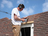 Twan bricklaying the bricksupright course of the garage