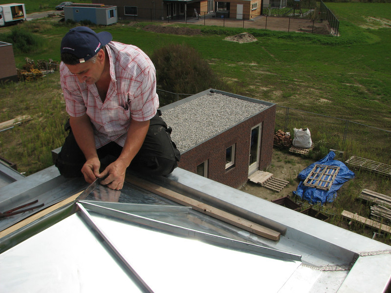 Jeroen mounting zinc roof parts of the dormer