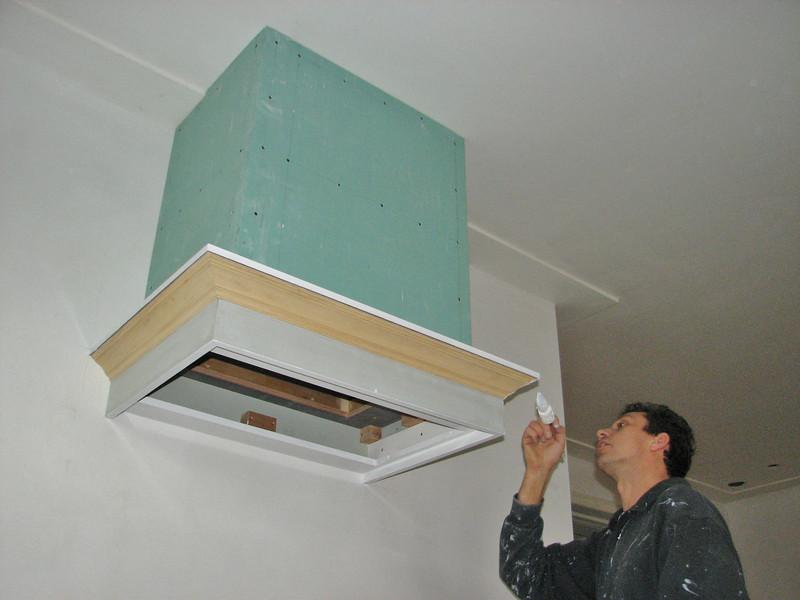 Robert is painting the cooker hood