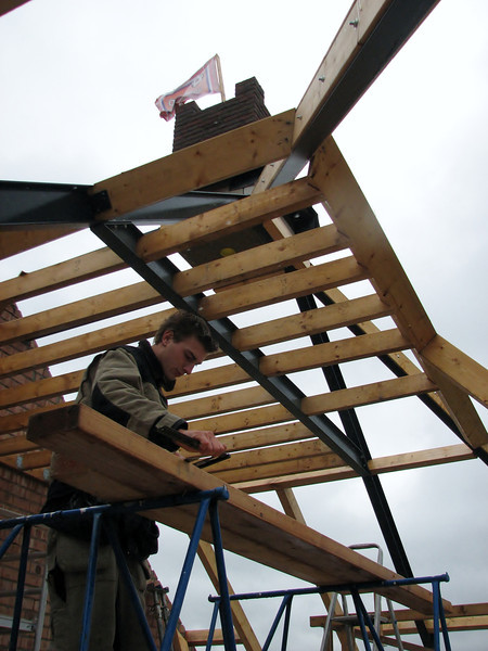 Making up wooden beams for the attic