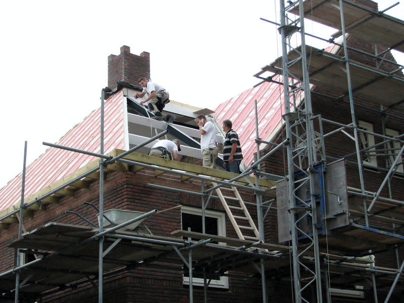Mounting team of roof insulation boards