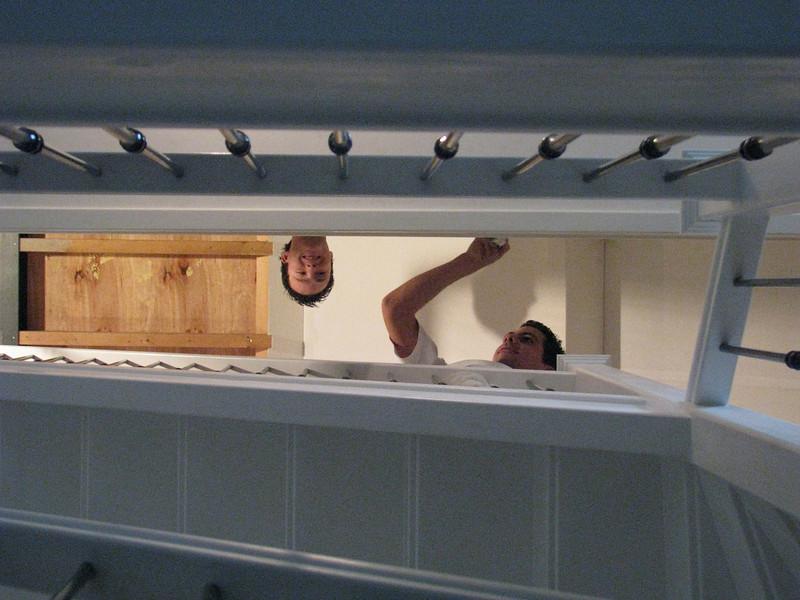 Rick and John are lacquering the stair handrail (firm Robert v.d. Wetering schilderwerken)