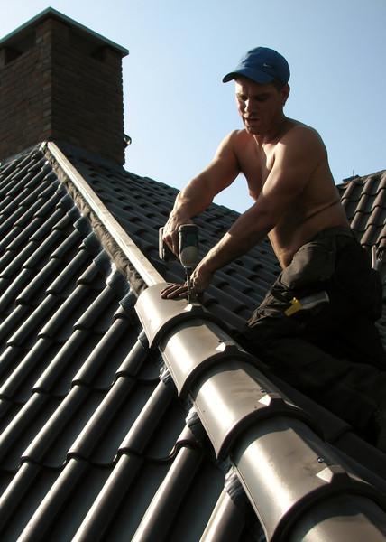 Angle ridge. Tilers roofing tiles