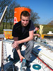Electrician student Niels mounting the spots