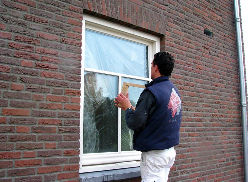 Robert and Rick sealing the windows