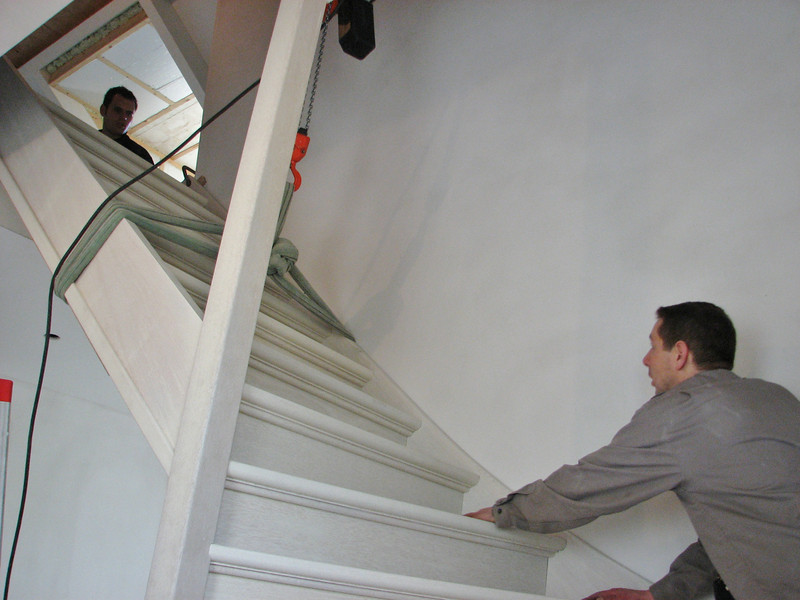 Hoisting the stair to the attic