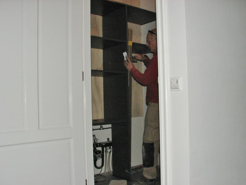 Marijn installing the cupboard of the scullery