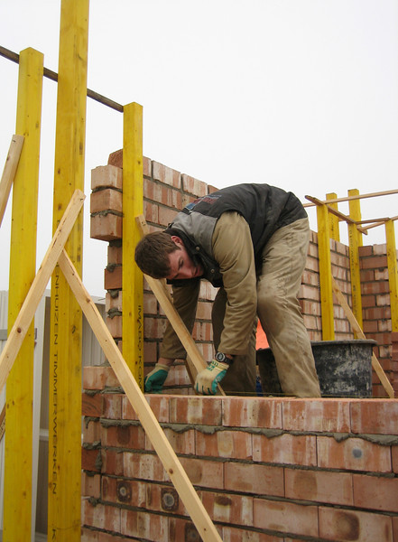 Paul bricklaying the interior walls of the ground floor