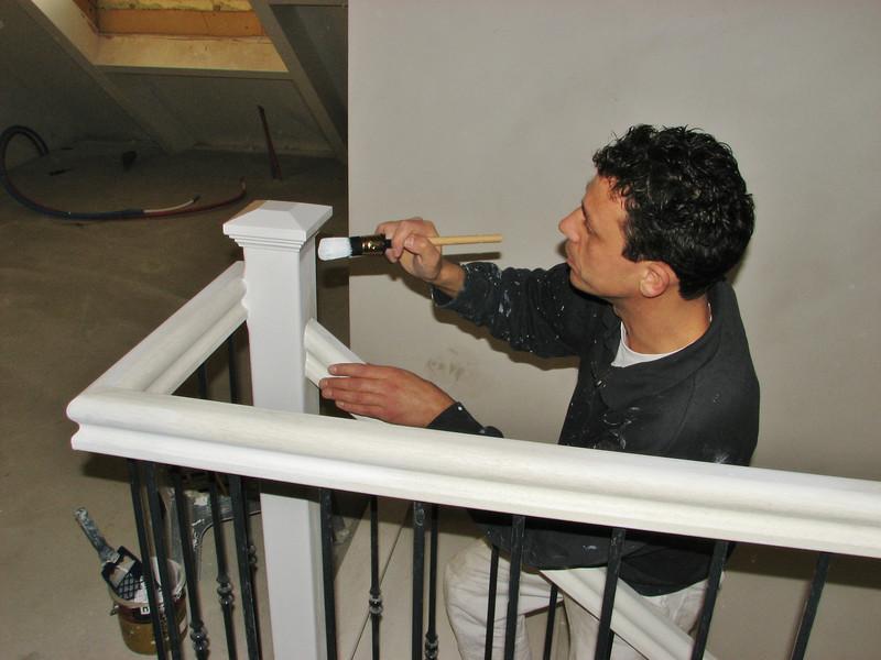 Robert is painting the bannisters (firm Robert v.d. Wetering schilder- en glaswerken)
