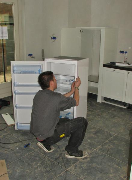 Assembling the fridge