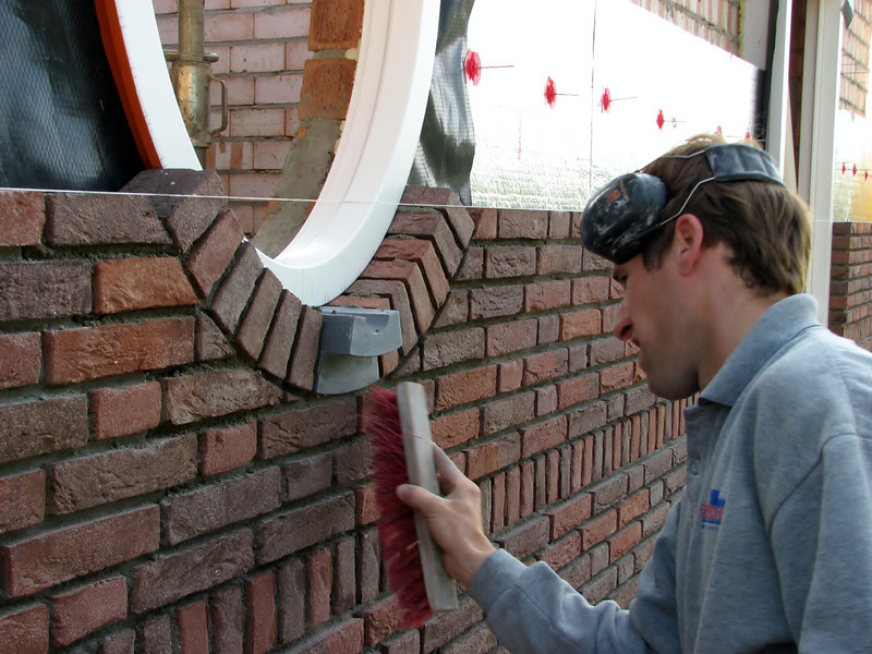 Paul cleaning the upright course of the oval window
