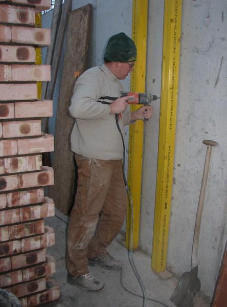 Twan drill the anchor holes