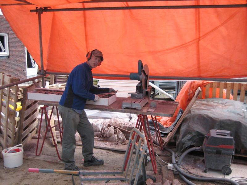 "Marijn sawing bricks in ""the sawing tent"""
