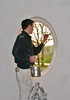 Rick lacquer the oval window frame for (firm Robert v.d. Wetering)