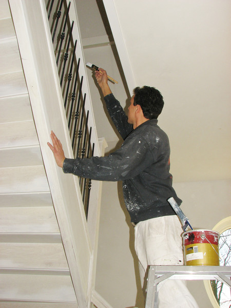 Robert is painting the handrail of the stair