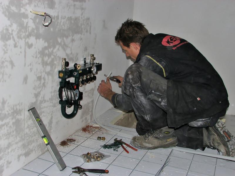 Erick installing the floor heating unit