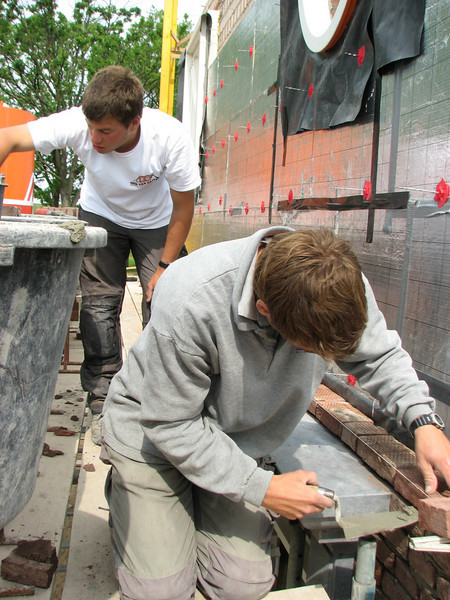 The van Gastel brothers bricklaying the South wall